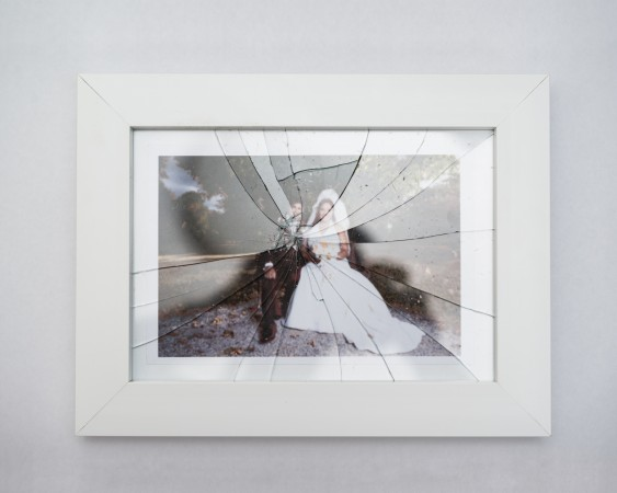 shattered photo of couple on their wedding day