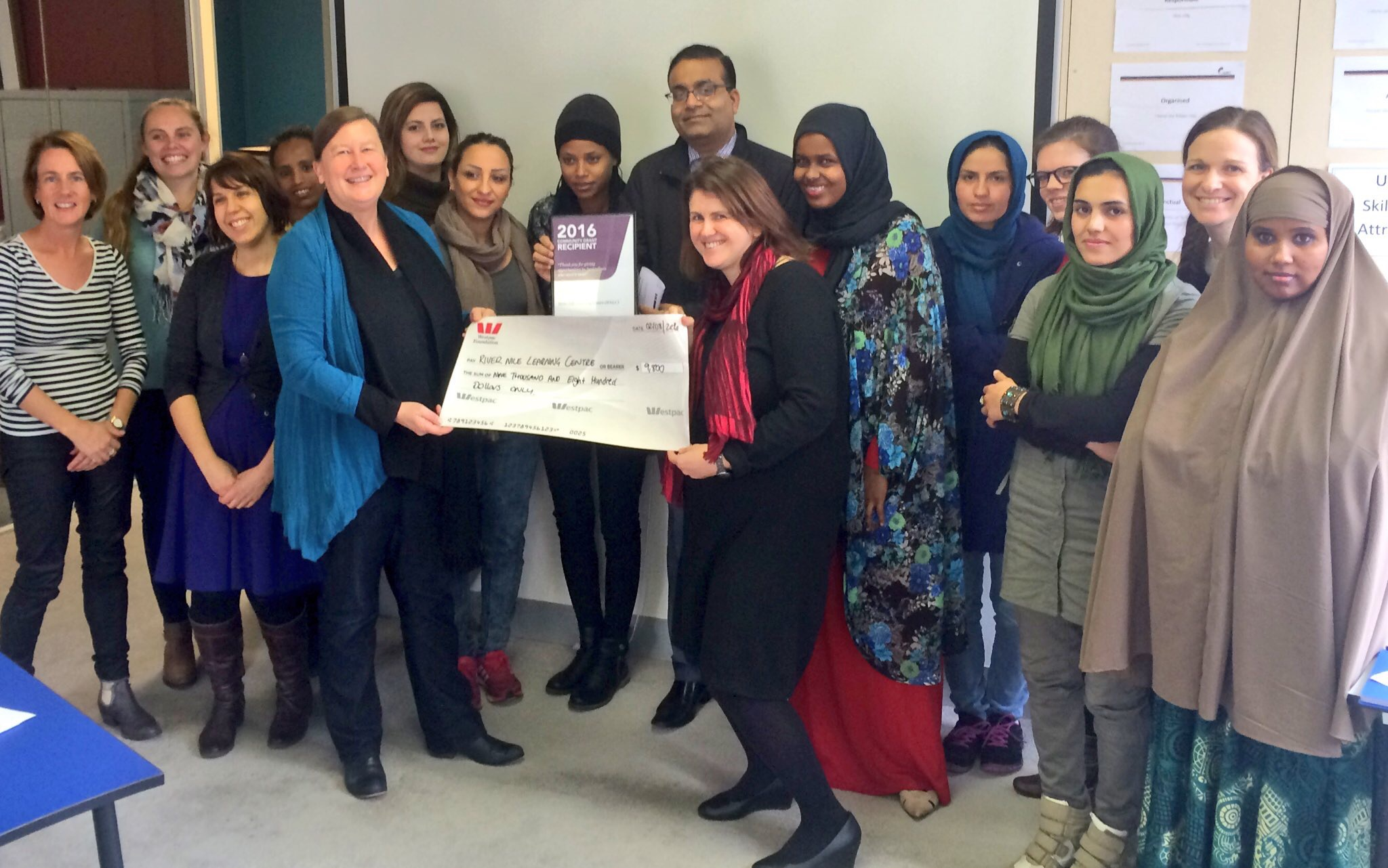 River Nile Learning Centre receiving their community grant cheque